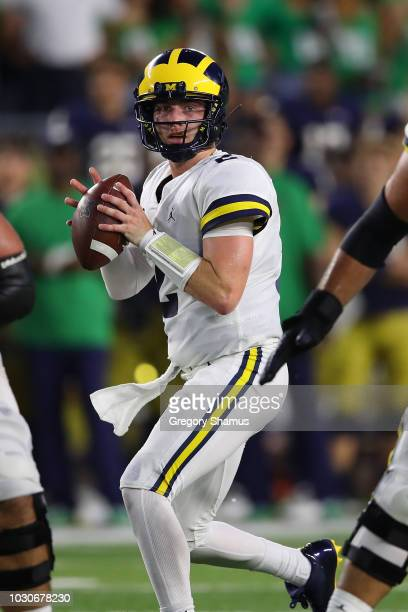 Shea Patterson of the Michigan Wolverines looks to throw while playing the Notre Dame Fighting Irish at Notre Dame Stadium on September 1 2018 in...