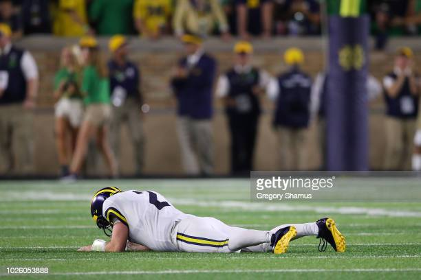 Shea Patterson of the Michigan Wolverines reacts after a fourth quarter fumble while playing the Notre Dame Fighting Irish at Notre Dame Stadium on...