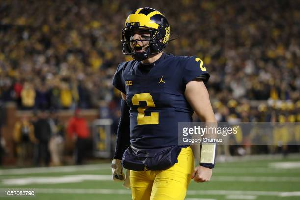 Shea Patterson of the Michigan Wolverines reacts to a a Karan Higdon first half touchdown while playing the Wisconsin Badgers on October 13 2018 at...