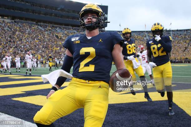 Shea Patterson of the Michigan Wolverines scores a first quarter touchdown while playing the Rutgers Scarlet Knights at Michigan Stadium on September...