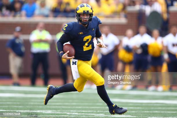 Shea Patterson of the Michigan Wolverines takes off on a second half run while playing the Southern Methodist Mustangs on September 15 2018 at...