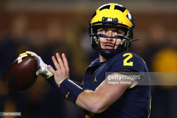 Shea Patterson of the Michigan Wolverines throws a first half pass while playing the Wisconsin Badgers on October 13 2018 at Michigan Stadium in Ann...