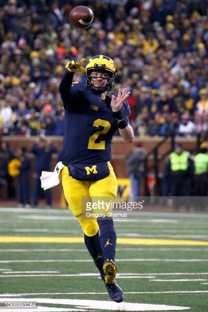Shea Patterson of the Michigan Wolverines throws a first half pass while playing the Indiana Hoosiers at Michigan Stadium on November 17 2018 in Ann...