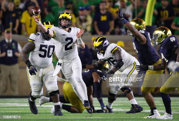 Shea Patterson of the Michigan Wolverines throws a pass while playing the Notre Dame Fighting Irish at Notre Dame Stadium on September 1 2018 in...