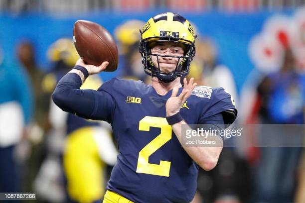 Shea Patterson of the Michigan Wolverines warms up prior to the ChickfilA Peach Bowl against the Florida Gators at MercedesBenz Stadium on December...