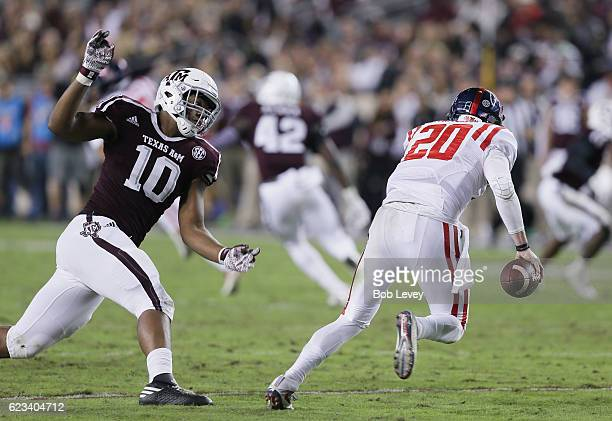 Shea Patterson of the Mississippi Rebels avoids Dyaeshon Hall of the Texas AM Aggies at Kyle Field on November 12 2016 in College Station Texas