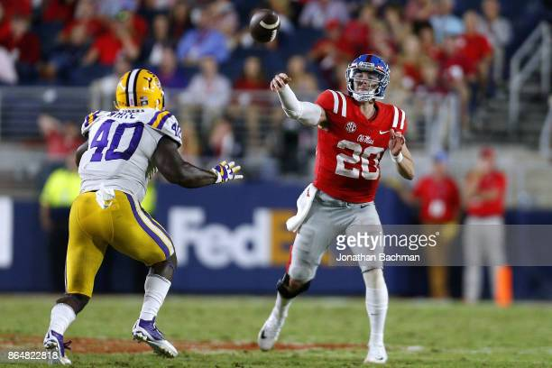 Shea Patterson of the Mississippi Rebels throws the ball as Devin White of the LSU Tigers defends during the second half of a game at VaughtHemingway...