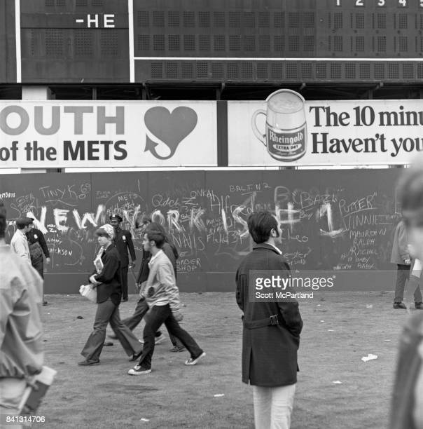 Fan celebration spirals out of control as some vandalize the back wall of the stadium with graffitti after the Mets win it all in Game 5 of the World...