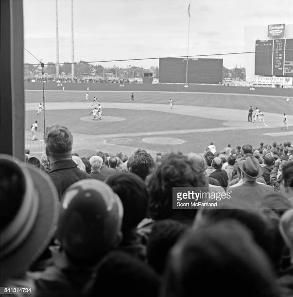 Shot taken from behind home plate Fans are on their feet as the NY Mets take on the Baltimore Orioles in Game 5 of the 1969 World Series