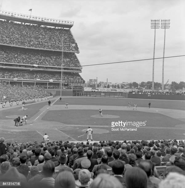 Taken from the right field side behind 1st base of fans watching intently as game 5 of the 1969 World Series gets underway as the Mets take on the...