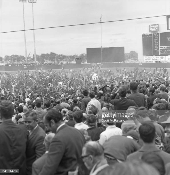 Thousands of fans storm the field and partially knock down the back wall of Shea Stadium as fan appreciation spirals out of control after the NY Mets...