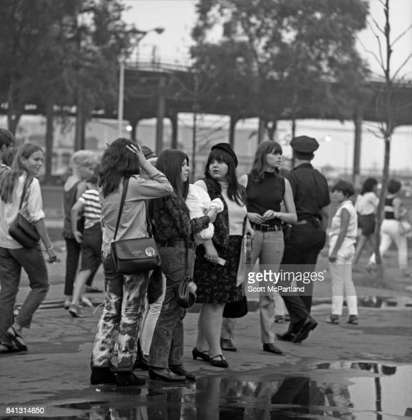 A group of teenage girls gather in the parking lot of Shea Stadium prior to The Beatles hitting the stage on their last American Tour