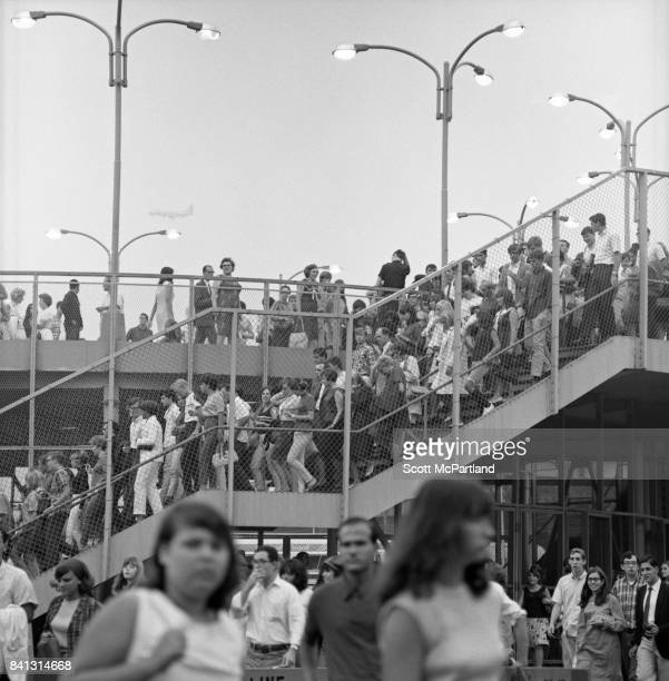 Hundreds of Beatles fans exit the 7 Train Subway stop in Corona Queens on their way to see The Beatles at Shea on their last American Tour