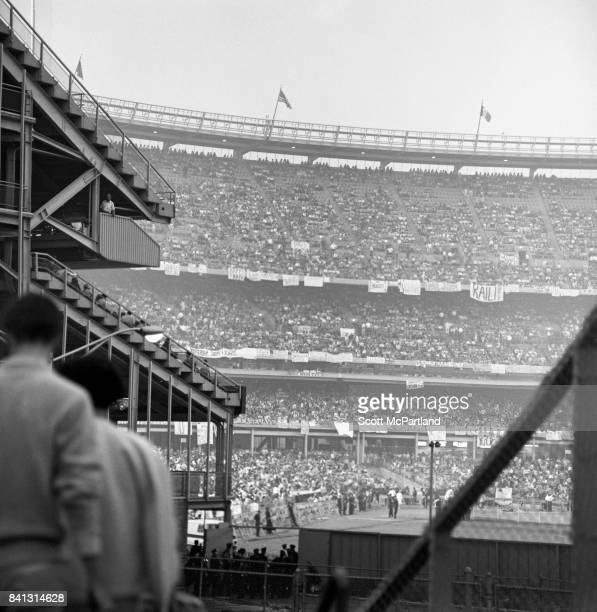 Shot taken from outside looking into a jam packed Shea Stadium as The Beatles prepare to take the stage on their last US Tour
