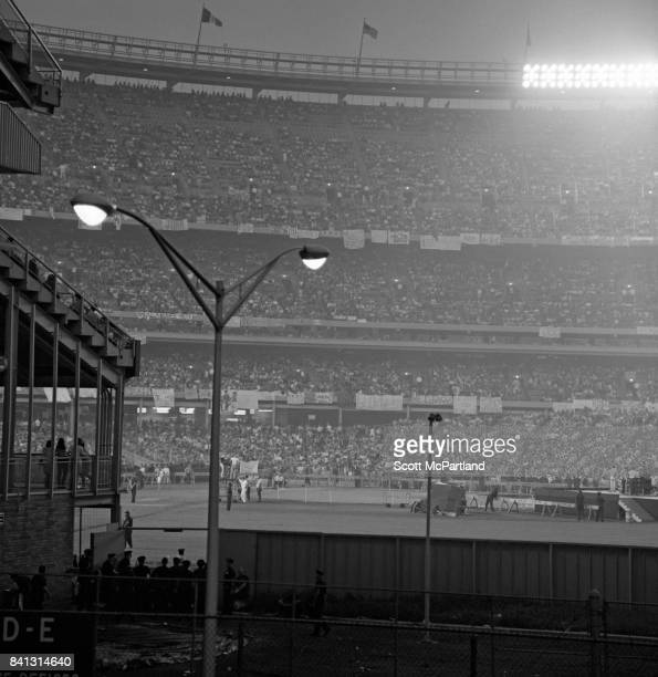 Shot taken from outside looking into a jam packed Shea Stadium just prior to The Beatles taking the stage on their last US Tour
