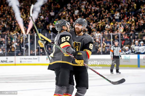 Shea Theodore and Alex Tuch of the Vegas Golden Knights celebrate a second period goal against the Winnipeg Jets at TMobile Arena on February 22 2019...
