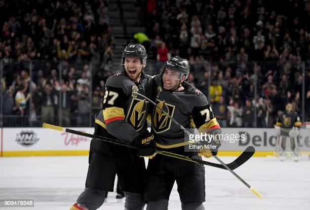 Shea Theodore and Brad Hunt of the Vegas Golden Knights celebrate after Hunt scored a secondperiod goal against the Columbus Blue Jackets during...