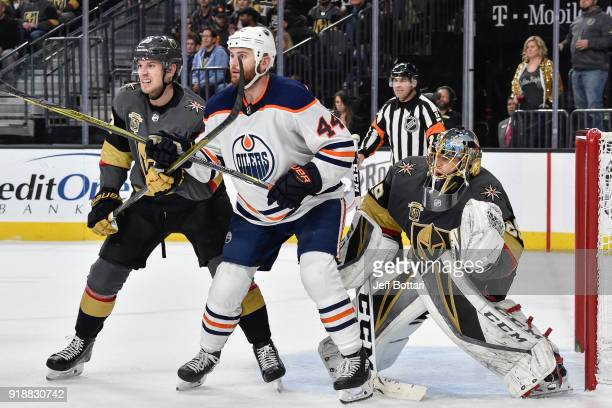 Shea Theodore and goalie MarcAndre Fleury of the Vegas Golden Knights defend their goal against Zack Kassian of the Edmonton Oilers during the game...
