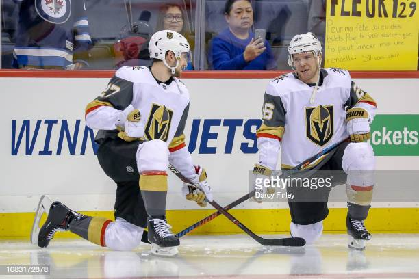 Shea Theodore and Paul Stastny of the Vegas Golden Knights chat during the pregame warm up prior to NHL action against the Winnipeg Jets at the Bell...