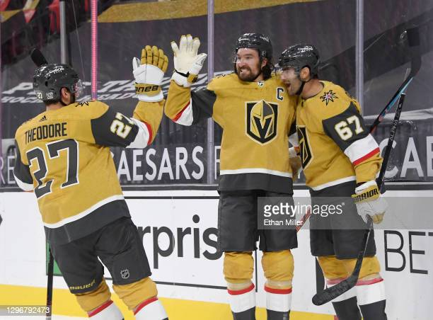 Shea Theodore, Mark Stone and Max Pacioretty of the Vegas Golden Knights celebrate after Stone assisted Pacioretty on an overtime goal against the...