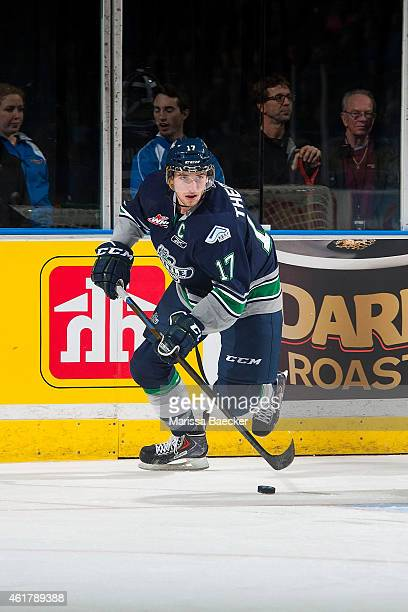 Shea Theodore of Seattle Thunderbirds skates with the puck against the Kelowna Rockets on January 16 2015 at Prospera Place in Kelowna British...
