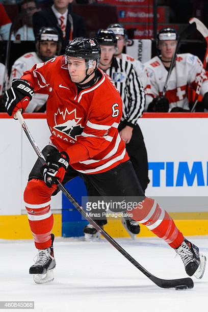 Shea Theodore of Team Canada takes a shot during the 2015 IIHF World Junior Hockey Championship exhibition game against Team Switzerland at the Bell...