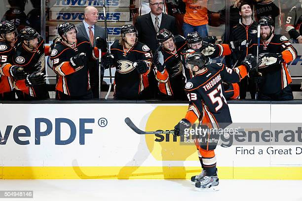 Shea Theodore of the Anaheim Ducks is congratulated by his teammates after scoring a goal during the third period of a game against the Ottawa...