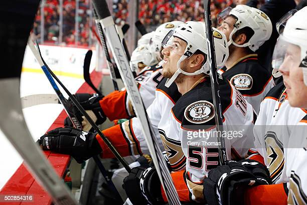 Shea Theodore of the Anaheim Ducks sits on the bench against the Calgary Flames during an NHL game at Scotiabank Saddledome on December 29 2015 in...