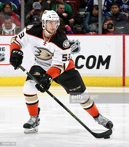 Shea Theodore of the Anaheim Ducks skates up ice with the puck during their NHL game against the Vancouver Canucks at Rogers Arena January 1 2016 in...