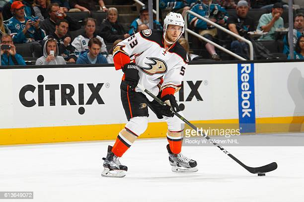 Shea Theodore of the Anaheim Ducks skates with the puck against the San Jose Sharks at SAP Center on October 5 2016 in San Jose California