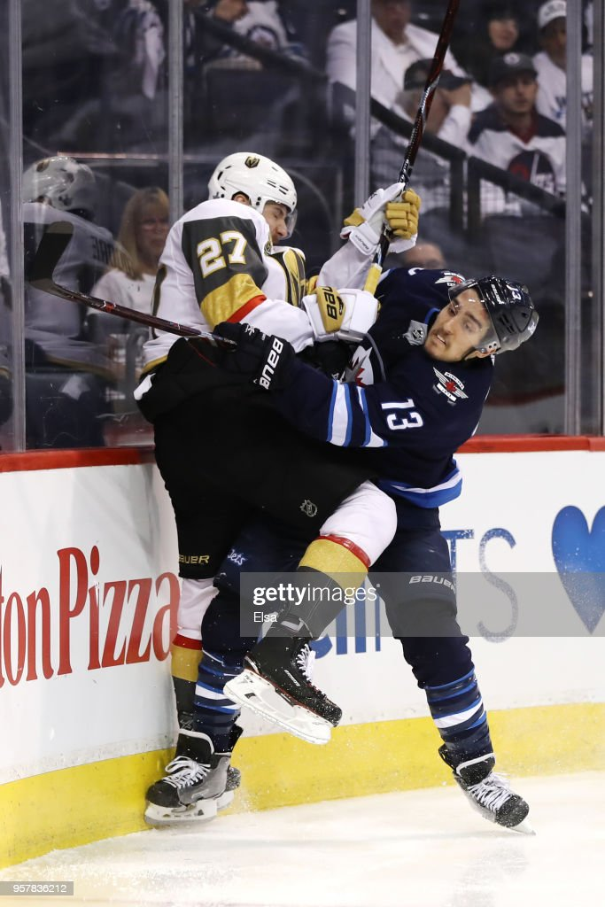 Shea Theodore #27 of the Vegas Golden Knights and Brandon Tanev #13 of the Winnipeg Jets collide during the second period in Game One of the Western Conference Finals during the 2018 NHL Stanley Cup Playoffs at Bell MTS Place on May 12, 2018 in Winnipeg, Canada.
