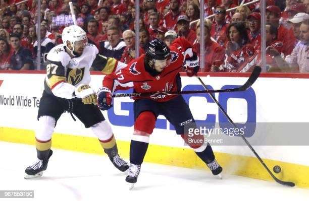 Shea Theodore of the Vegas Golden Knights and TJ Oshie of the Washington Capitals battle for the puck during the first period in Game Four of the...