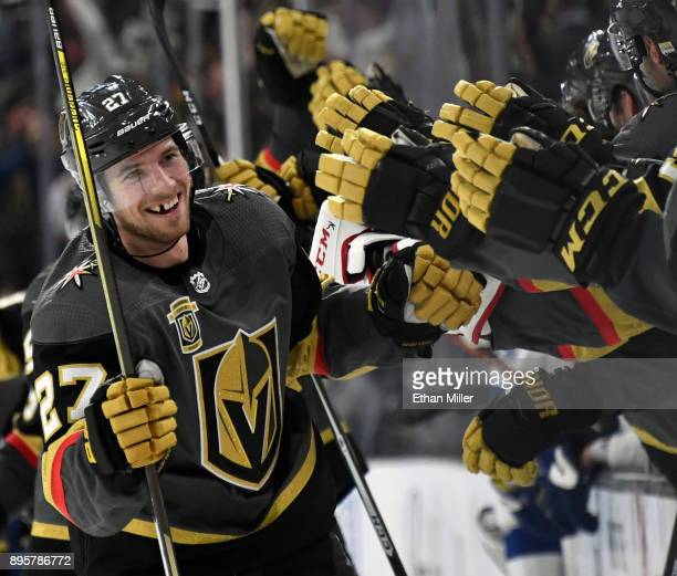 Shea Theodore of the Vegas Golden Knights celebrates with teammates after scoring on a powerplay goal with 23 seconds left in the third period to...
