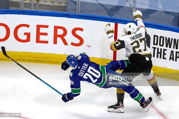 Shea Theodore of the Vegas Golden Knights checks Brandon Sutter of the Vancouver Canucks during the second period in Game Four of the Western...