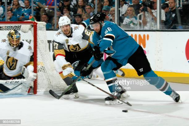 Shea Theodore of the Vegas Golden Knights defends Melker Karlsson of the San Jose Sharks in Game Six of the Western Conference Second Round during...