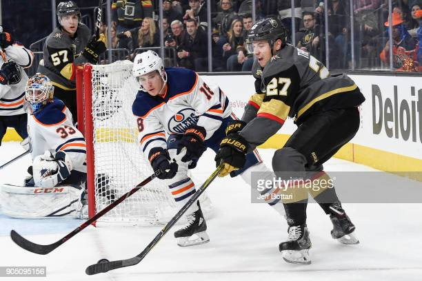 Shea Theodore of the Vegas Golden Knights handles the puck with Ryan Strome of the Edmonton Oilers defending during the game at TMobile Arena on...