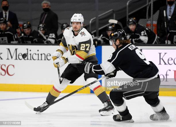 Shea Theodore of the Vegas Golden Knights has his pass intercepted by Adrian Kempe of the Los Angeles Kings during the first period at Staples Center...