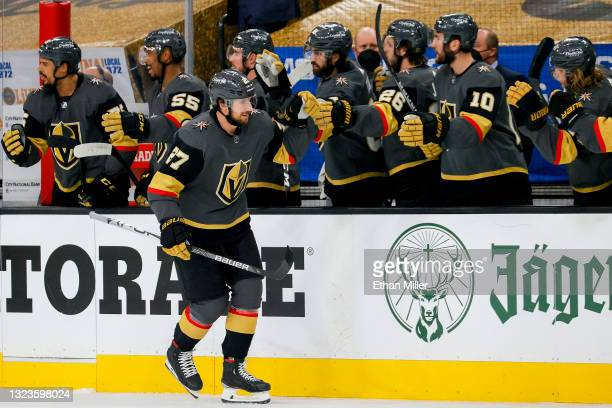 Shea Theodore of the Vegas Golden Knights is congratulated by his teammates after scoring a goal against the Montreal Canadiens during the first...