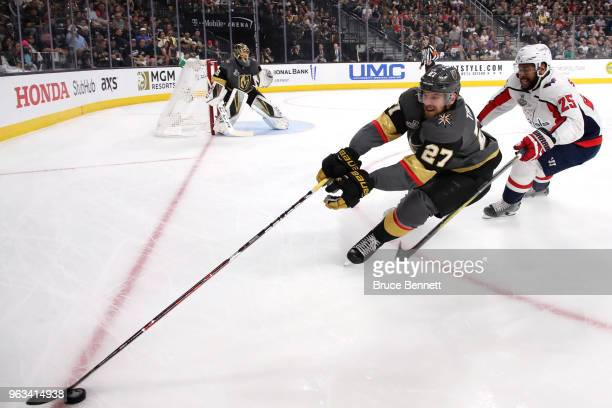 Shea Theodore of the Vegas Golden Knights is defended by Devante SmithPelly of the Washington Capitals during the first period in Game One of the...