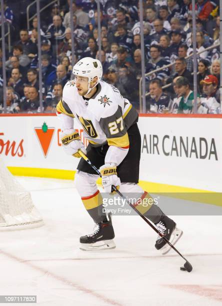 Shea Theodore of the Vegas Golden Knights plays the puck behind the net during first period action against the Winnipeg Jets at the Bell MTS Place on...