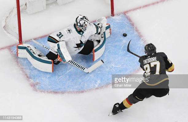 Shea Theodore of the Vegas Golden Knights scores a firstperiod goal against Martin Jones of the San Jose Sharks in Game Four of the Western...