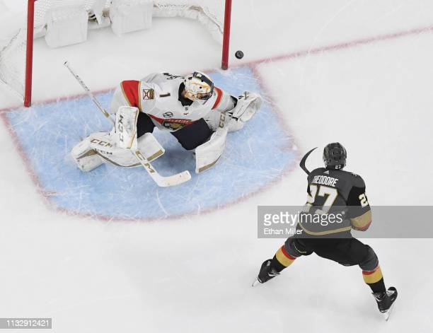 Shea Theodore of the Vegas Golden Knights scores a shootout goal against Roberto Luongo of the Florida Panthers during their game at T-Mobile Arena...