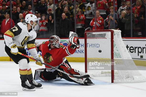 Shea Theodore of the Vegas Golden Knights scores the game winning goal against Robin Lehner of the Chicago Blackhawks during a shootout at the United...