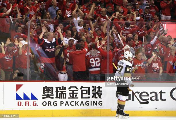 Shea Theodore of the Vegas Golden Knights skates by as Washington Capitals fans celebrate after Devante SmithPelly scored a goal in the third period...