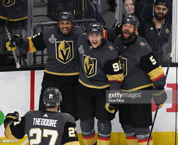 Shea Theodore of the Vegas Golden Knights skates over to celebrate with teammates Ryan Reaves Tomas Nosek and Deryk Engelland after Theodore assisted...