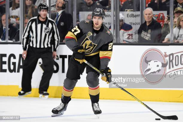 Shea Theodore of the Vegas Golden Knights skates with the puck against the Edmonton Oilers during the game at TMobile Arena on January 13 2018 in Las...