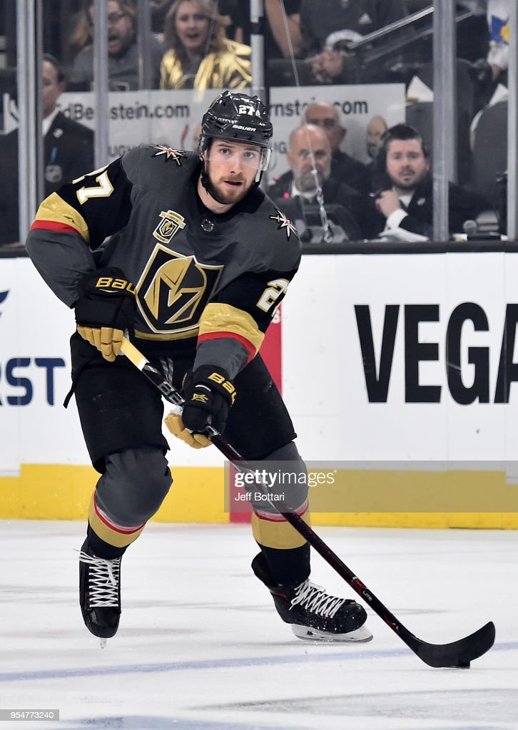 Shea Theodore #27 of the Vegas Golden Knights skates with the puck against the San Jose Sharks in Game Five of the Western Conference Second Round during the 2018 NHL Stanley Cup Playoffs at T-Mobile Arena on May 4, 2018 in Las Vegas, Nevada.