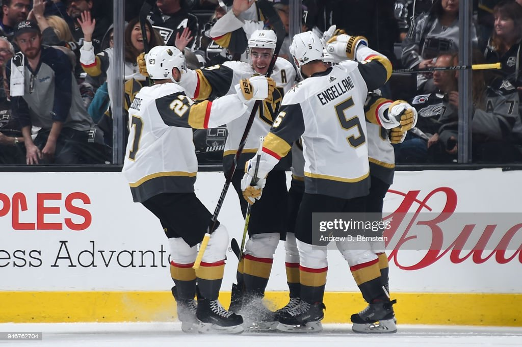 Shea Theodore #27, Reilly Smith #19, and Deryk Engelland #5 of the Vegas Golden Knights celebrate after scoring a goal against the Los Angeles Kings in Game Three of the Western Conference First Round during the 2018 NHL Stanley Cup Playoffs at STAPLES Center on April 15, 2018 in Los Angeles, California.