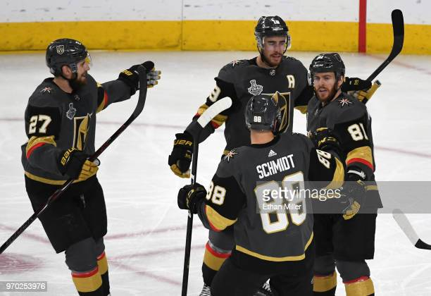 Shea Theodore Reilly Smith and Jonathan Marchessault of the Vegas Golden Knights celebrate after Smith and Marchessault assisted Nate Schmidt on a...