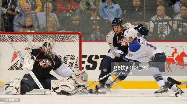 Shea Weber and Anders Lindback of the Nashville Predators battle in the crease against Andy McDonald of the St Louis Blues during an NHL game on...